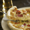 料理メニュー写真自家製のミックスピザ S