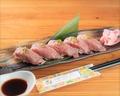 料理メニュー写真沖縄県産和牛の炙り握り 一貫