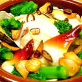 料理メニュー写真ほっき貝、つぶ貝、ムール貝、小柱の入った4種の甲斐のガーリックバター焼き