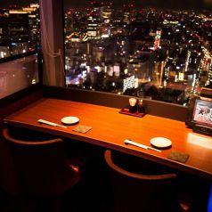 カップルシートは目の前に夜景♪【汐留でお食事処、飲み会を実施するお店をお探しなら北海道へ】