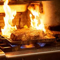 迫力の塊肉!したたる肉汁!グリルした本格肉料理!