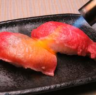 人気メニュー《黒毛和牛の炙り肉寿司2貫380円(税別)》