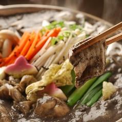 料理メニュー写真豆乳仕立て黒胡麻味噌鍋~上和牛もつホル鍋~