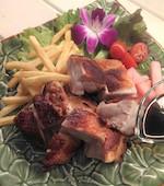 リゾートダイニング フランジパニ 流山おおたかの森駅前店の国産森林鶏のガイヤーン(プーケットの照り焼きチキン)の写真