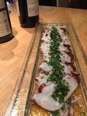 ONE DROP ワンドロップ 大名の北海生タコのごま油ネギ塩仕立ての写真