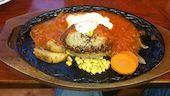 けん 加古川店の4種のチーズソースとトマトソースのチェダーチーズinハンバーグ 180gの写真