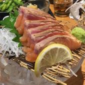魚と肉 あし跡 三宮店のとろサーモンの半殺し/カンパチの半殺しの写真