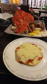 北海料理 古艪帆来 コロポックルの人気料理!【北あかりのトマトチーズ焼】の写真