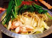 てき 松山の白もつ鍋(和風)/赤もつ鍋(チゲ)/出世もつ鍋(和風→チゲ)の写真