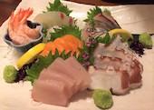 地鶏酒家 黒かしわの鮮魚の刺し盛りの写真
